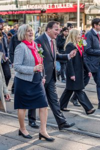 Goteborg, Sweden - May 1, 2016: A happy Swedish Prime Minister Stefan Lofven with his wife walking in the May 1 protest march in Gothenburg city in 2016.